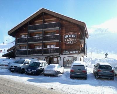 Guy Pessey Sport et Hôtel Les Flocons.